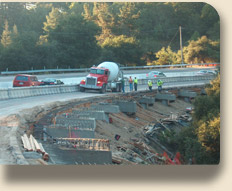 construction truck and workers working on the Laural Curve project