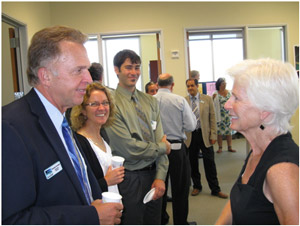 Executive Director Dondero chats with Commissioner Pirie as RTC staff Ginger Dykaar and Matt Leal look on.
