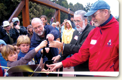 Neal Coonerty and Sam Farr, with constituents, cut a ribbon to inaugurate the San Lorenzo River Bicycle/Pedestrian Bridge