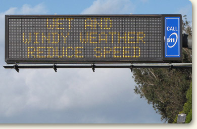 Photo of changeable message sign: Wet and windy weather, reduce speed