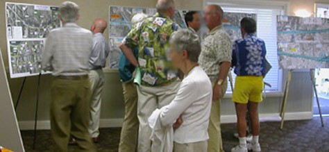 people at an open house viewing displays