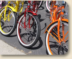 orange, red and yellow bicycles lined up in a row